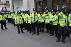 Riot Police on Standby in Central London. Police on standby in central London after violent clashes during a large anti-cuts rally on March 26, 2011 in London Royalty Free Stock Image