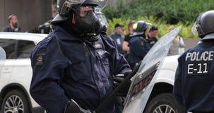 Riot police standby