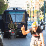 Riot police with their shield, take cover during a rally in front of the Athens University Royalty Free Stock Image