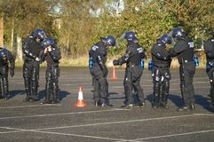 Riot police unit, city policing crime and antisocial behaviour. Street riot, public unrest stock images