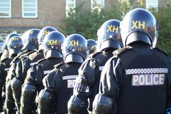 Riot police unit, city policing crime and antisocial behaviour. Street riot, public unrest stock photography