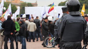 Riot police watching passing rally, Russia stock video