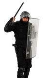 Riot policeman attacking. Riot policeman with nightstick and shield attacking isolated stock image