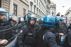 Riot policemen during the Liberation Day parade. MILAN, ITALY - APRIL 25: Riot policemen follow the Liberation Day parade, end of Mussolini`s regime and Nazi Royalty Free Stock Images