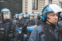 Riot policemen during the Liberation Day parade. MILAN, ITALY - APRIL 25: Riot policemen follow the Liberation Day parade, end of Mussolini`s regime and Nazi Stock Photos