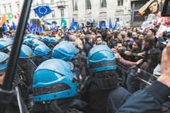 Riot policemen during the Liberation Day parade. MILAN, ITALY - APRIL 25: Riot policemen follow the Liberation Day parade, end of Mussolini`s regime and Nazi Royalty Free Stock Photo