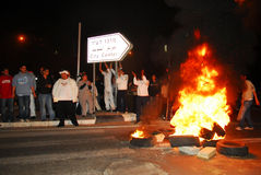 Riot. SDEROT, ISR - FEB 02:Angry Sderot residents blocking the main streets in Sderot on February 9 2008.Two Sderot residents were seriously wounded when a Stock Images