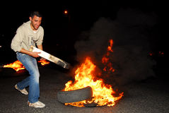 Riot. SDEROT, ISR - FEB 02:Angry Sderot residents blocking the main streets in Sderot on February 9 2008.Two Sderot residents were seriously wounded when a Stock Photo