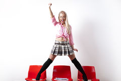 Riot student standing up with a miniskirt Royalty Free Stock Images