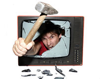 Riot tv. Screaming young man with hammer Stock Image
