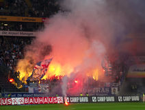 Rioting Football Fans. Frankfurt, Germany, September 16, 2011: Ultras, Hooligans from German Soccer Club Hansa Rostock rioting with pyrotechnics, illumination Royalty Free Stock Image