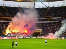Rioting Ultras. Frankfurt, Germany, September 16, 2011: Ultras, Hooligans from German Soccer Club Hansa Rostock rioting with pyrotechnics, illumination rockets Stock Images