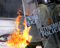 Riots. A police motor bike is burning after a petrol bomb was thrown during riots in front of the parliament in Athens February 23, 2011. Greek police clashed