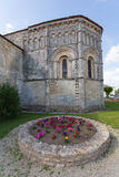 Rioux church abse. Abse and flowers of the romanesque Rioux church,Charente, France Royalty Free Stock Photos