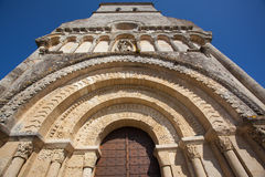 Rioux church entrance. Main entrance archivolts detail of the Rioux church .Region of Charente in France Royalty Free Stock Photos