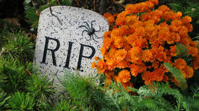 Rip. Halloween grave stones with orange flower Stock Image