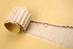 Rip in cardboard Stock Image