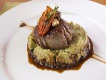 Rip eye steak. On top of hash potato Stock Photo
