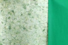 Rip green natural handmade paper Stock Photo