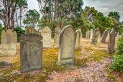 Rip Halloween tombstones. Old tombstones in the Isle of the Dead located in the harbor off Port Arthur, Tasman Peninsula, Tasmania, Australia Royalty Free Stock Photo