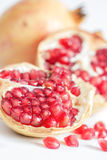 Rip pomegranate on close up shot Stock Image