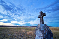 RIP tombstone. A granite tombstone topped with a cross bearing inscription R.I.P Stock Photo