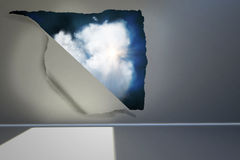 Rip on wall showing cloud Royalty Free Stock Images