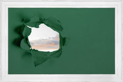 Rip on wall showing sky Royalty Free Stock Photo