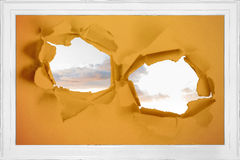 Rip on wall showing sky Royalty Free Stock Image