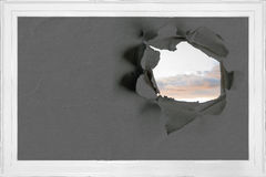 Rip on wall showing sky Royalty Free Stock Photos