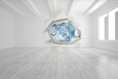 Rip on wall showing technology interface Royalty Free Stock Images