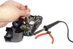 Riparando videocamera - isolata Fotografie Stock Libere da Diritti