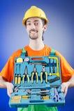 Riparatore con la sua borsa degli arnesi Fotografia Stock