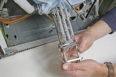 Riparazione degli apparecchi della lavatrice Fotografia Stock Libera da Diritti