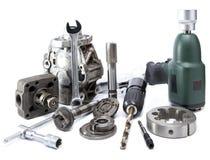 Riparazione dell'automobile - dettagli della pompa della chiave pneumatica dell'aria e di alta pressione su fondo bianco Fotografie Stock Libere da Diritti