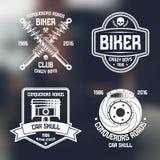 Riparazione dell'automobile ed emblemi del club del motociclista Fotografie Stock