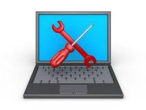 Ripari gli strumenti e un computer portatile Fotografia Stock Libera da Diritti
