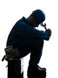 Ripari la siluetta triste di rottura a fatica dell'operaio dell'uomo fotografia stock libera da diritti