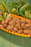 New harvest of almonds, ripe almonds and fresh green almonds on Stock Photo