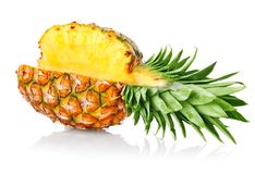 Ripe ananas fruit with green leaves. Isolated on white background Royalty Free Stock Photo