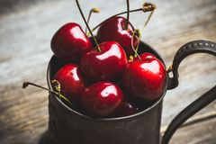 Free Ripe And Juicy Cherries In Old Metal Cup On The Dark Rustic Background Royalty Free Stock Photography - 152363747