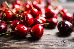 Free Ripe And Juicy Cherries On The Dark Rustic Background Royalty Free Stock Images - 153347879