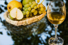 Ripe appetizing grape, pears and glass of wine Stock Images