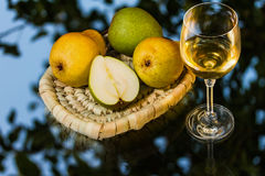 Ripe appetizing pears and glass of wine Royalty Free Stock Image