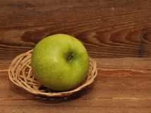 Ripe apple in basket Royalty Free Stock Photo