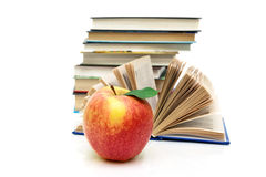 Ripe apple and books on a white background Stock Photo