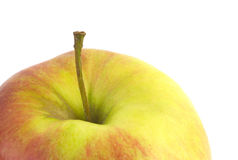 Ripe apple fragment isolated closeup Stock Image