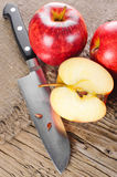 Ripe apple fruits and knife Stock Photo