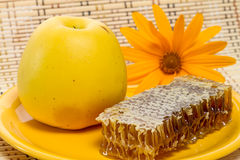 Ripe apple and honey in the comb Stock Photo