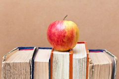 Ripe apple and vintage books Royalty Free Stock Image